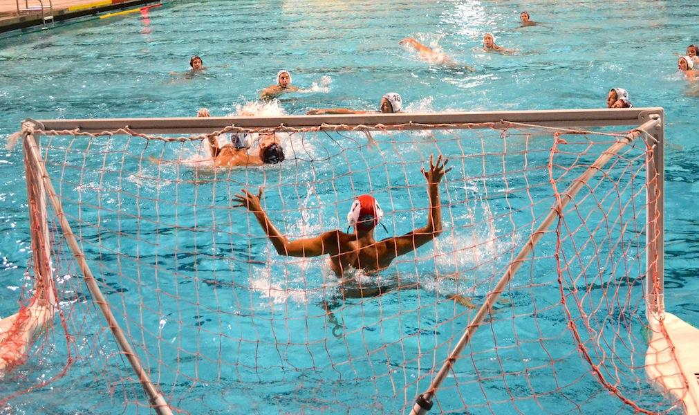 Paly senior goalkeeper Jake Weinstein guards the goal against the Titan's offense.