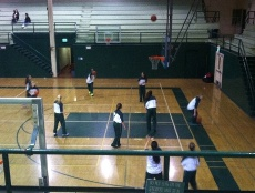 Paly's girls basketball team warms up before taking the court against San Mateo. Photo by Maddy Jones.