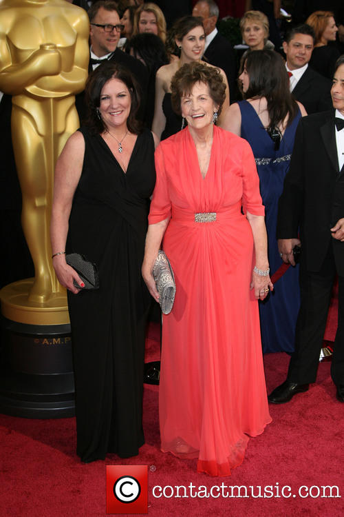 Pictured is Philomena Lee and in the background you can spot Grace together with her dad Rex on the red carpet in Los Angeles, Mar. 2. [Photo:  contactmusic.com]