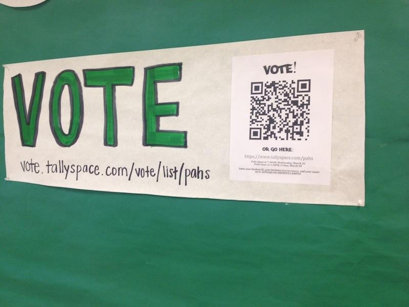 """""""Vote"""" poster and smartphone QR code outside the Student Activities Office. Voter turnout in the 2014 election sharply increased from previous years. Photo by Drew Keller."""