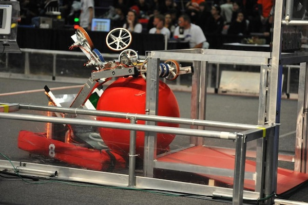 The Palo Alto High School's (((School)))robotics team's robot is putting the exercise ball into one of the goals to score a point. The robotics team is competing in a tournament over Spring Break. Photo by Chris Linn.