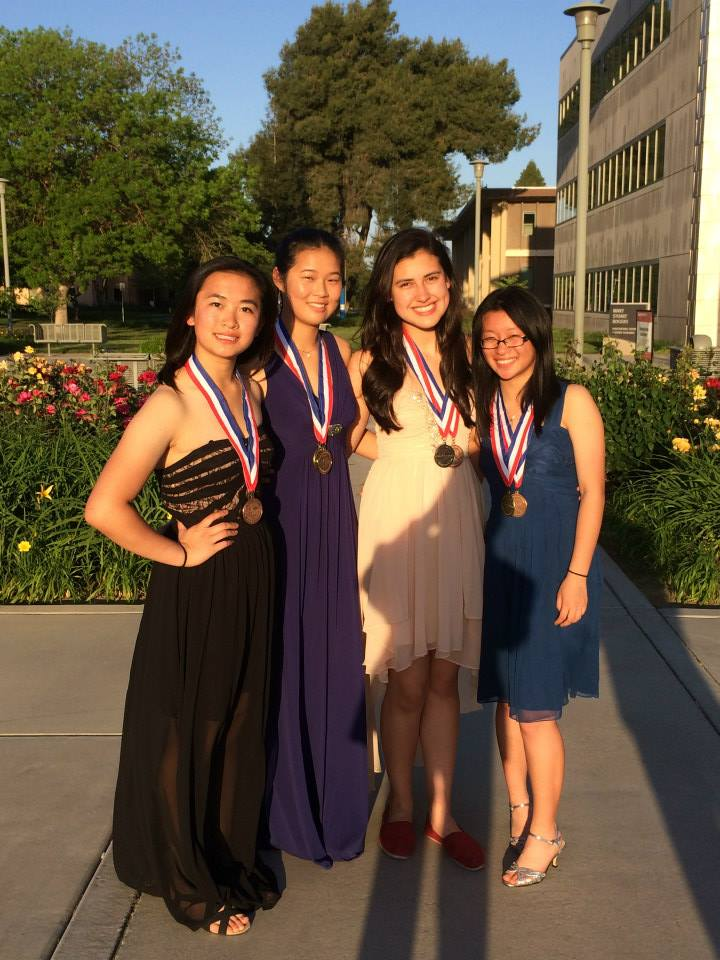 Seniors Annie Chen and Grace Lin pose with sophomores Sylvia Targ and Ivy Li before driving to Prom in San Francisco straight from the Northern California Science Olympiad competition in Turlock. Photo courtesy of Nick Quach.
