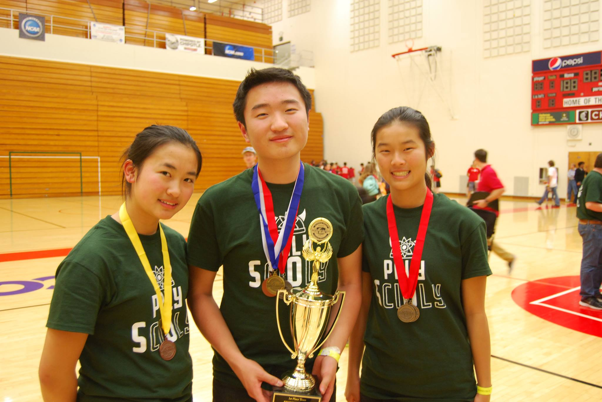 Science Olympiad team captains, senior Annie Chen, junior Ken Chen and senior Grace Lin, pose with the hardware they earned at the regional competition in March. The team earned second place in the Northern California State Championship Saturday. Photo courtesy of Yingjian Chen.