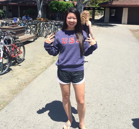 Senior Lily Zhang poses in her U.S.A. table tennis shirt. She has returned from the World Championships in Japan, where her world rank jumped to number 66.