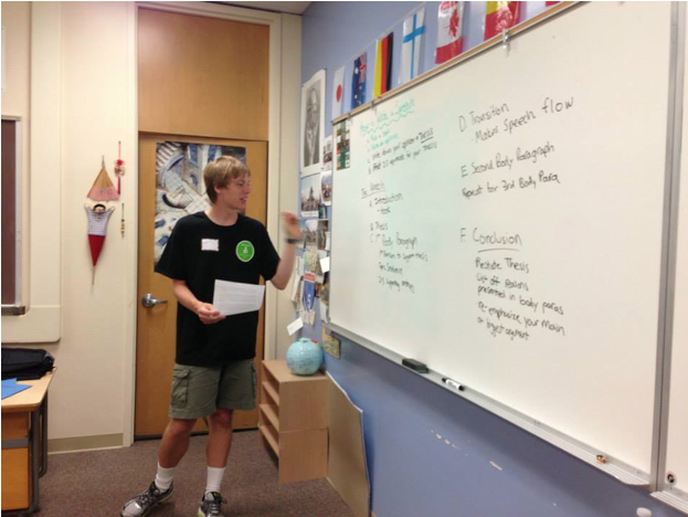 Caption: Previous counselor of Palo Alto Speech and Debate Camp senior Jared Filseth lectures to the speech section of the camp. The camp offers classes in public speaking, debate, impromptu speech and advanced Lincoln-Douglas style debate. Photo by Noa Braun.