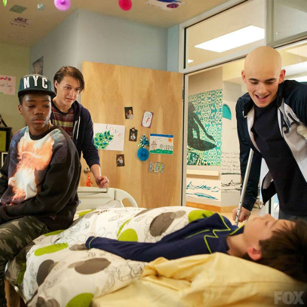 "In the new Fox dramedy ""Red Band Society,"" Dash (Astro), Jordi (Nolan Sotillo) and Leo (Charlie Rowe) (left to right) visit their coma-stricken friend Charlie (Griffin Cluck) and talk about their current conditions. The three teens have cystic fibrosis, osteosarcoma and an amputated leg, respectively, while Charlie is in a coma for an unspecified reason. ""Luck isn't getting what you want,"" said Leo, referring to their health. ""It's surviving what you don't want."" (FOX)"
