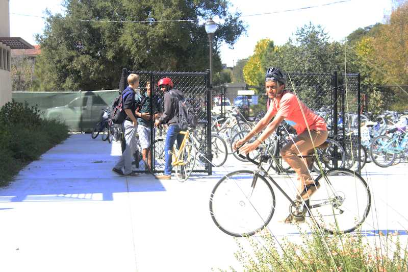 """Anant Marur bikes out of the Palo Alto High School campus.  Marur is a frequent biker.  """"I think the police should be focusing on more important,"""" Marur says."""