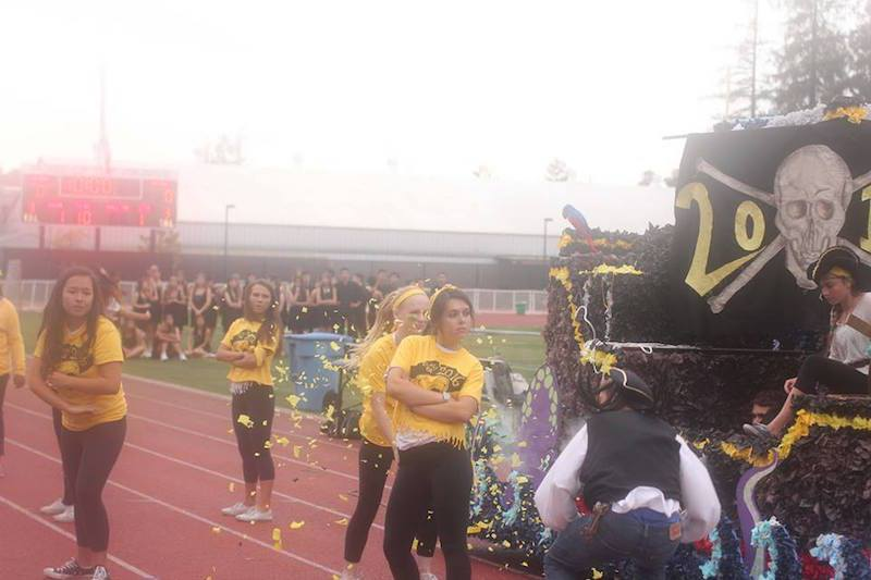Juniors Clara Wolfe, Rachel Selingson, Emma Scott and Aiva Petriceks pose as Griffin Carlson jumps of the float. Photo by George Lu.