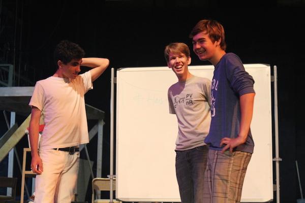 Sophomore Jason Pollak, junior Paul Bleich and sophomore Joey Kellison-Linn enjoy comedy sports in the Haymarket theater. Photo by Emma Chiu.