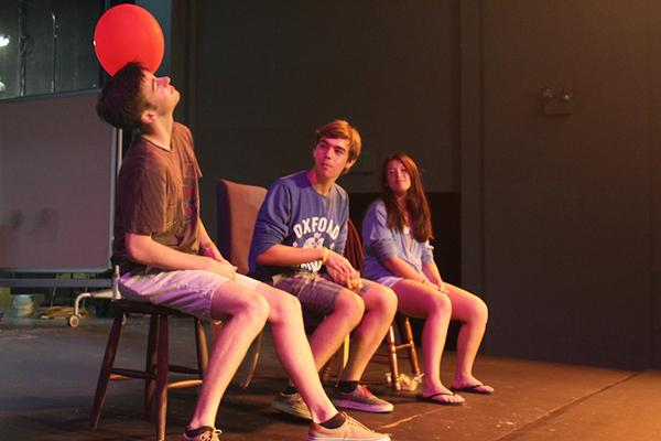Senior Will Kast plays with an air balloon during the improv troupe auditions.Photo by Emma Chiu