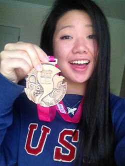 Lily Zhang poses for a selfie with her bronze medal from the 2014 Youth Olympic Games. Photo by Lily Zhang.