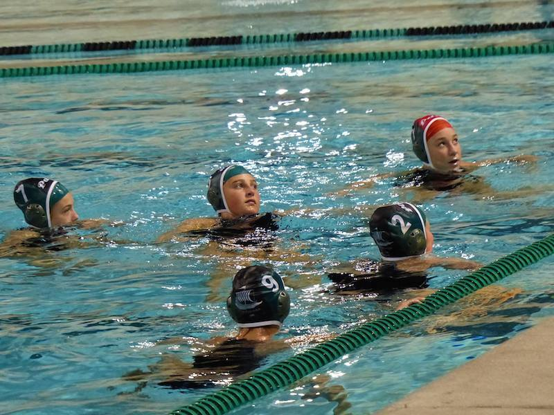 The girls water polo team treads water as head coach Aileen Delaney gives out instructions. The Vikings defeated the Wildcats by a score of 12-7. Photo by Samuel Desre.