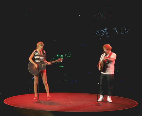 "Singer-songwriter Taylor Swift and fellow friend and musician Ed Sheeran sing ""Everything Has Changed"" to a crowd of 17,000 in Sacramento, California during the 2013 Red Tour. Sheeran, an opening act on the North American leg of Swift's tour, makes a guest appearance during Swift's set at every show to perform their duet. ""We [Sheeran and I] became pals right away,"" Swift said in an interview with Capital FM. ""We write songs the same way and we have a similar sense of humor."" Photo by Jeanette Wong."
