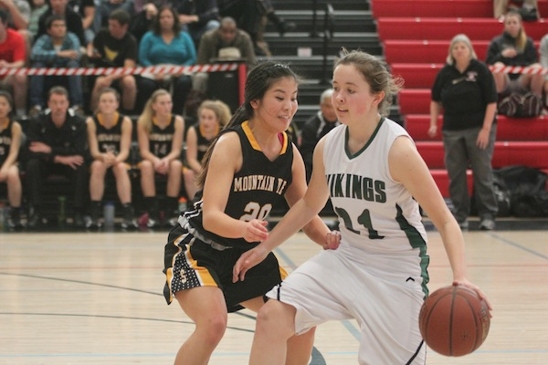 Sophomore Julie Chandler protects the ball from a Mountain View defender during last season's CCS quarter-final victory on March 4. The Vikings defeated the Spartans 57-54. Photo by Maddy Jones.