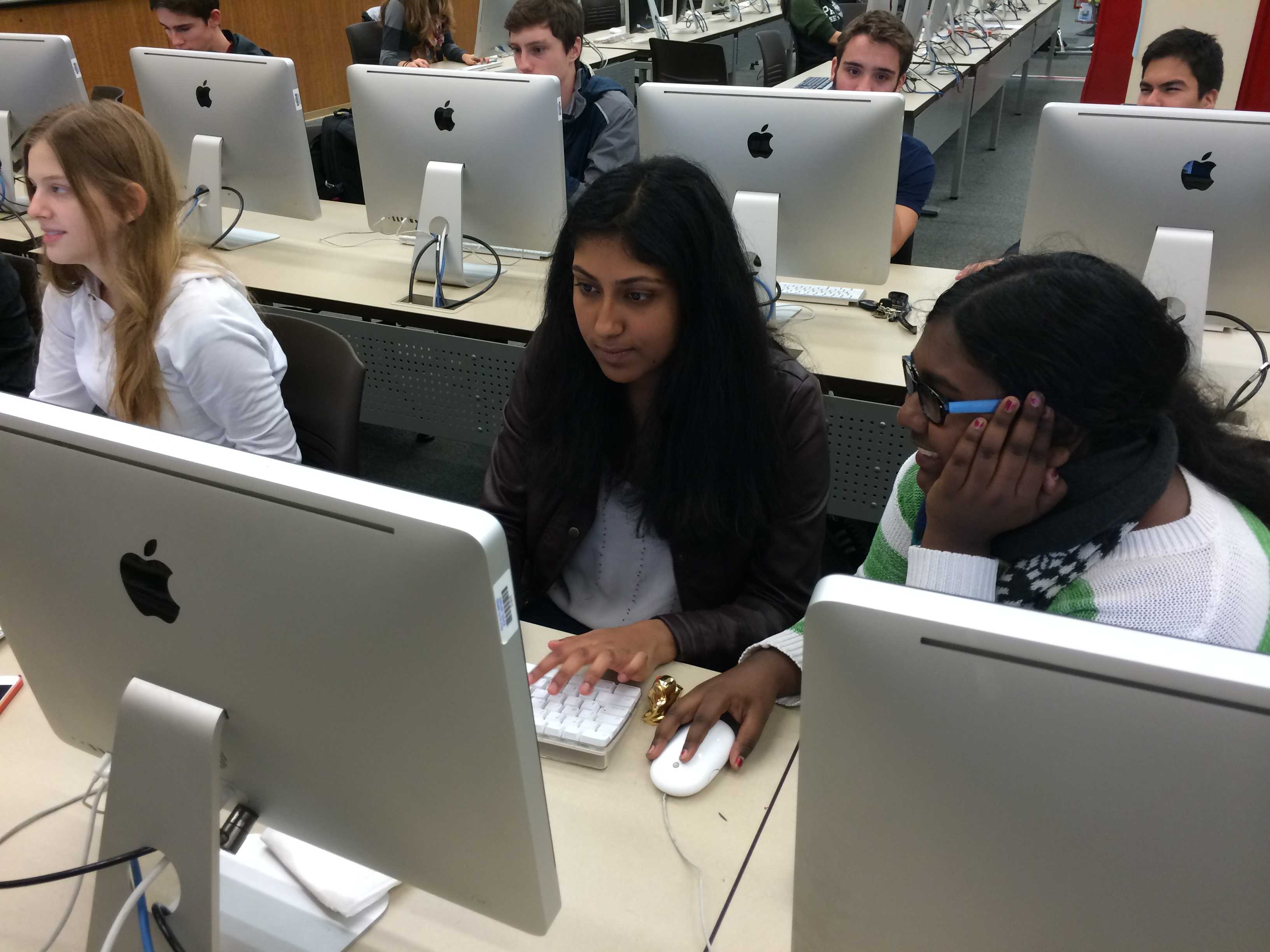 Seniors Jozy Prabhu and Ankita Avadhani scroll through college emails in the Paly Library. Students check college-related emails frequently on campus. Photo by Lydia Barry.