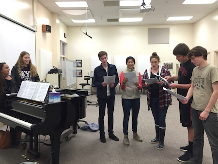 Senior Will Kast and Jamie Garcia rehearse with other choir students juniors Chris Crews-Holloway, Ryan Jamison and other girl. This year the speaking parts in the performance will be shared with members of concert choir not just the advanced vocal groups. Photo by Alex Merkle-Raymond