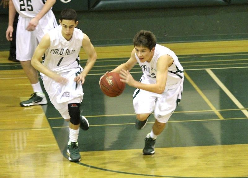 Senior Kevin Mullin rebounds the ball and drives to score. Paly defeated Saratoga High School 66-31 on Jan. 22, 2014. Photo by Edward Mei.