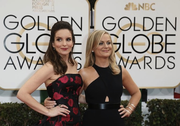 Comedians Tina Fey (L) and Amy Poehler (R) will host the 72nd annual Golden Globes. Photo courtesey of Reuters.