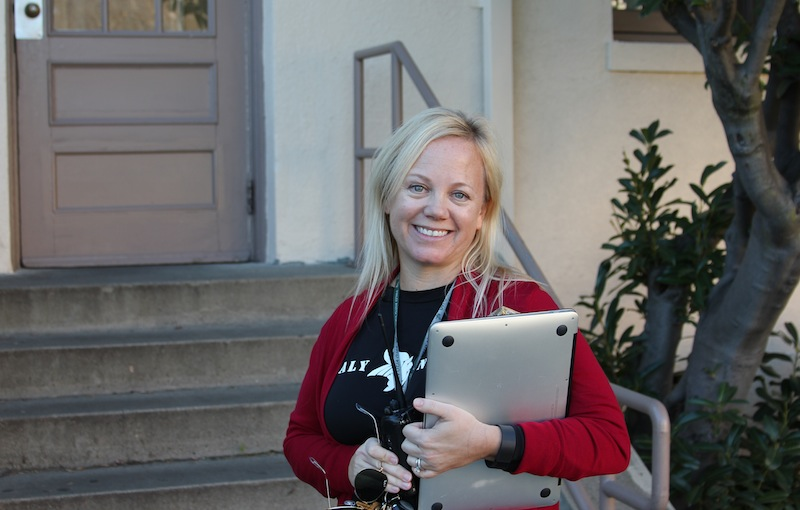 Paly Principal Kim Diorio stands outside of the Tower Building. Diorio is wearing red and black today in support of Gunn High School. Diorio and ASB worked to create a list of ways to reduce academic stress and improve the school climate. Photo by George Lu.