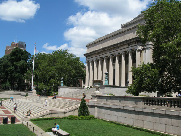 "Students chat and read on the steps of the Low Memorial Library at Columbia University. One of the Paly alumni, currently an undergraduate student at Columbia, will share her experiences at the university tomorrow at ""Listen and Learn."""
