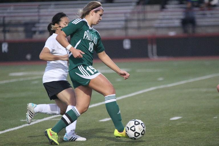 Junior midfielder Jacey Pederson dribbles past a defender. Pederson made two goals. Photo by Maddy Jones.