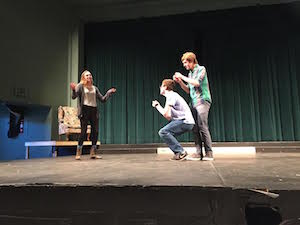 "Members of the Red Team- senior Christopher Hinstorff, junior Zoe Limbrick and sophomore Jason Pollack, practice an improv skit called ""Fast forward and rewind."" The skit involves the referee telling the actors to redo the line or skip ahead in the scene. Photo by Alex Merkle-Raymond."