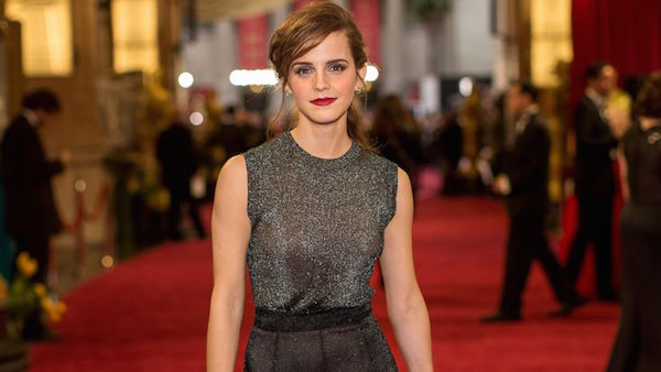 Emma Watson poses on the red carpet at the 86th annual Oscars ceremony on March 2, 2014. Photo courtesy of ABC News.