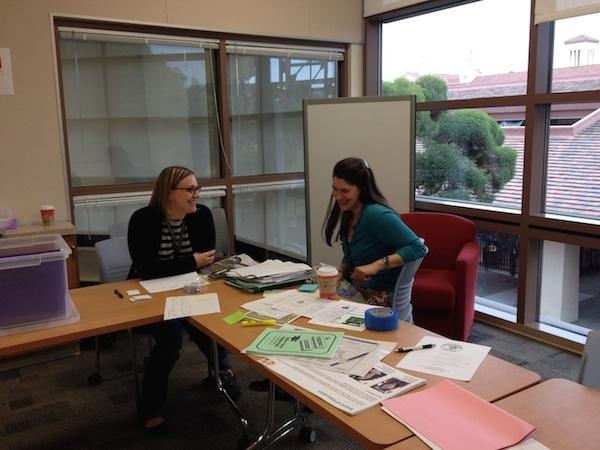 Garrison and Caitlin Wolf organize materials in preparation for the WASC visit on March 1. Photo by Maya McNealis.