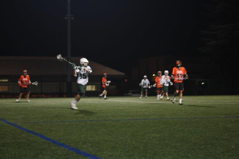 Senior midfielder Owen Staiger prepares to throw the ball. In this game, Paly defeated Woodside High School, 17-12, at 7 p.m. on March 4, 2015 at Palo Alto High School. Photo by Emma Chiu.