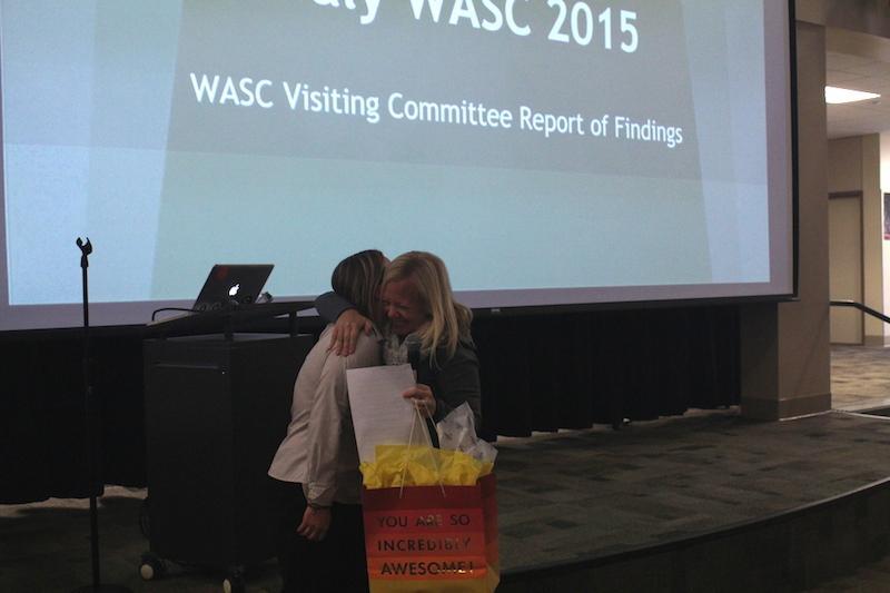 WASC Coordinator and Spanish teacher Emily Garrison and Principal Kim Diorio embrace after the positive WASC report. Photo by Takaaki Sagawa.