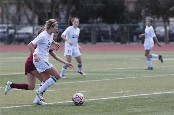 Junior Jacey Pederson drives forward with the ball in the CCS quarterfinals game against Menlo-Atherton (1-0). Pederson scored the only goal of the game in a skillful solo effort. Photo by George Liu.