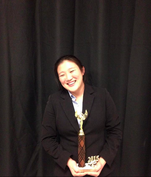 Junior Jenny Xin shows off her trophy won at the Coast Forensic League Satellite tournament last week. Her victory at the tournament makes her first ever Paly student to qualify for states. Photo courtesy of Gabi Rossner.