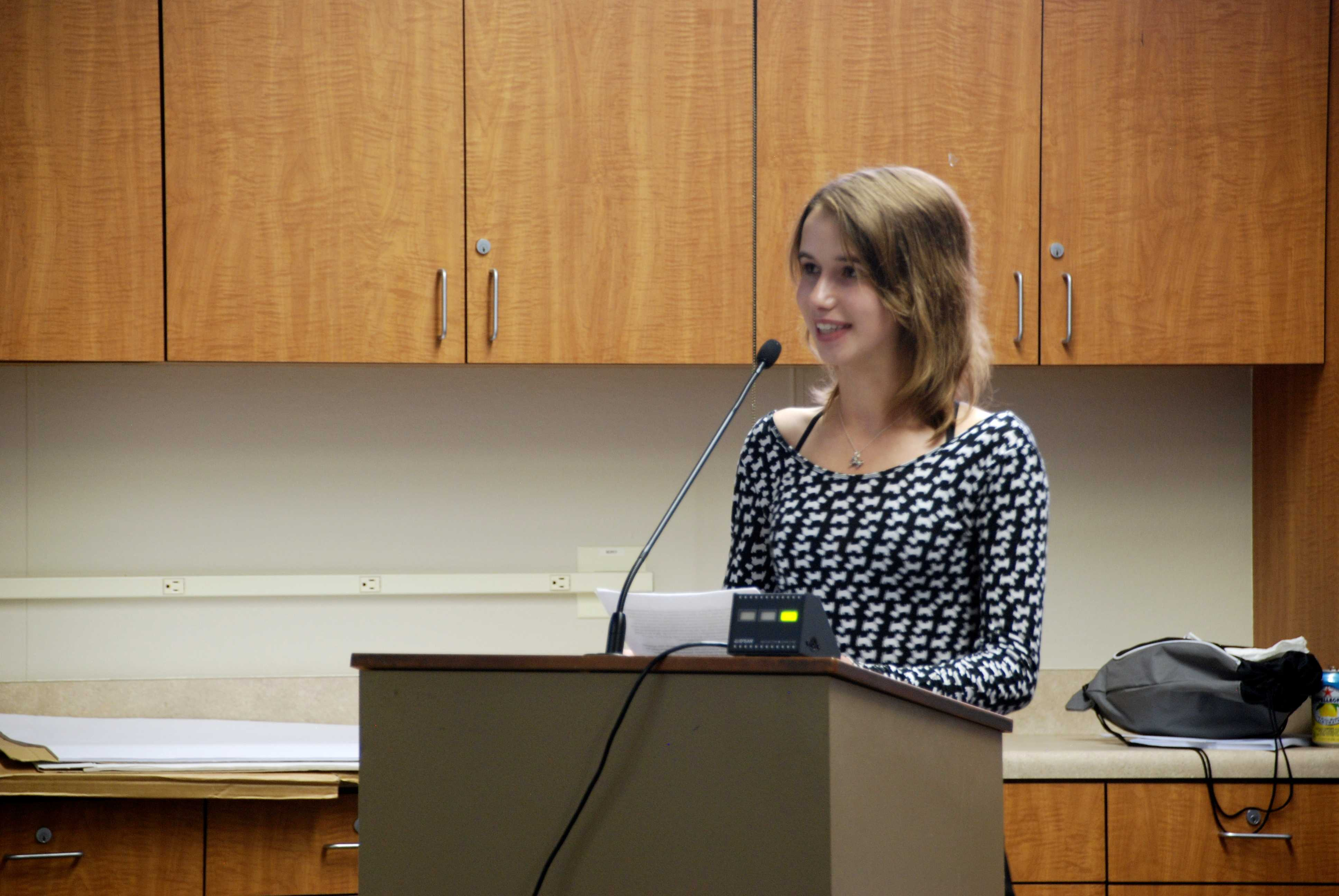 "Gunn sophomore Natalie Rozak speaks to the board members. ""Our voice matters,"" Rozak said. ""Please stop putting words into our mouths."" Photo by Jeanette Wong"