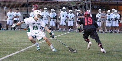 Senior captain Owen Staiger scrambles back to defend in a victory over Gunn on March 13. Photo by Amy Leung.