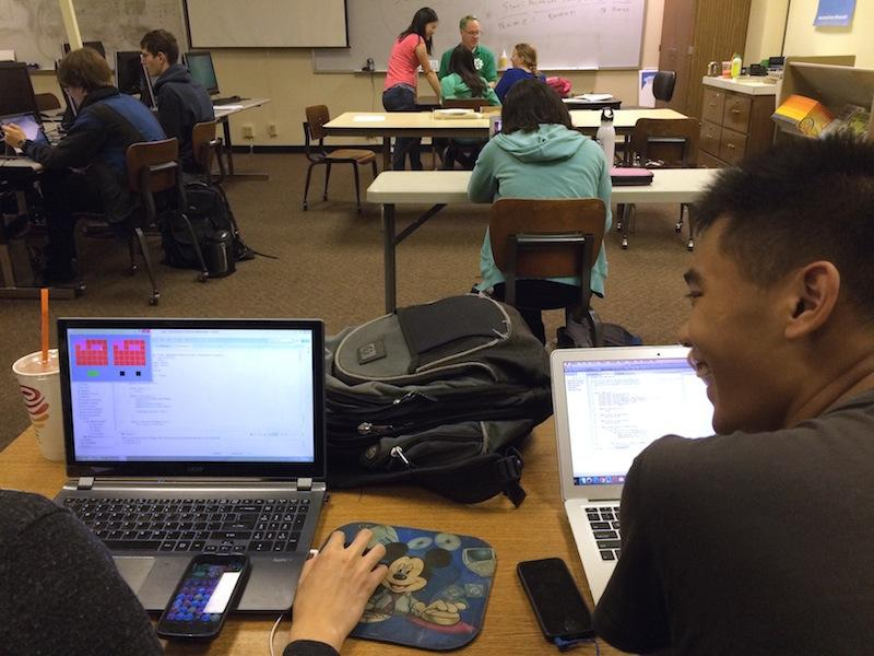 Palo Alto High School seniors Ryan Huang and Elnathan Au work on their computer science projects in class. High schoolers, especially girls, are welcome to sign up for the Stanford Women in Computer Science-hosted CS conference on May 2. Photo by Lizzie Chun.