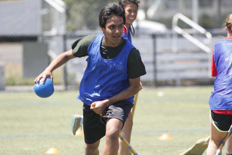 Junior Anant Marur runs with a dodgeball during the Quidditch finals. The juinors beat the seniors and took first place in the activity. Photo by George Lu.