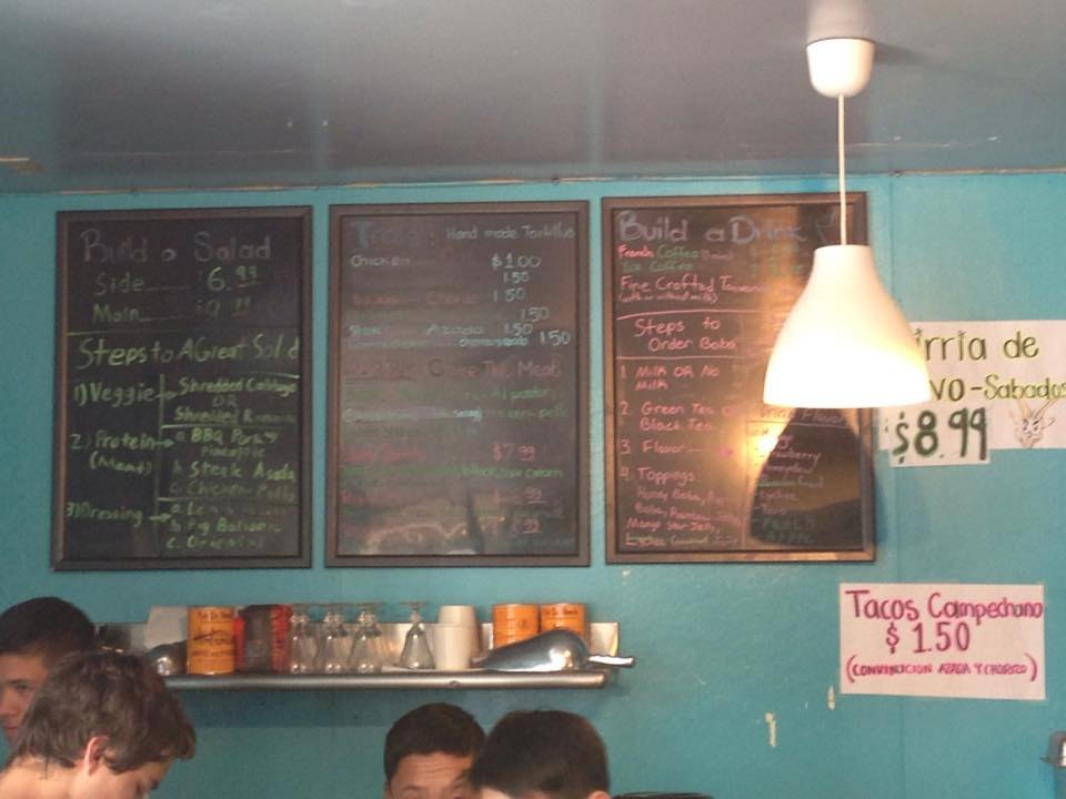 The chalk menu shows the inexpensive delicacies sold at Valencia Asian Market. Photo by Emilia Diaz-Magaloni.