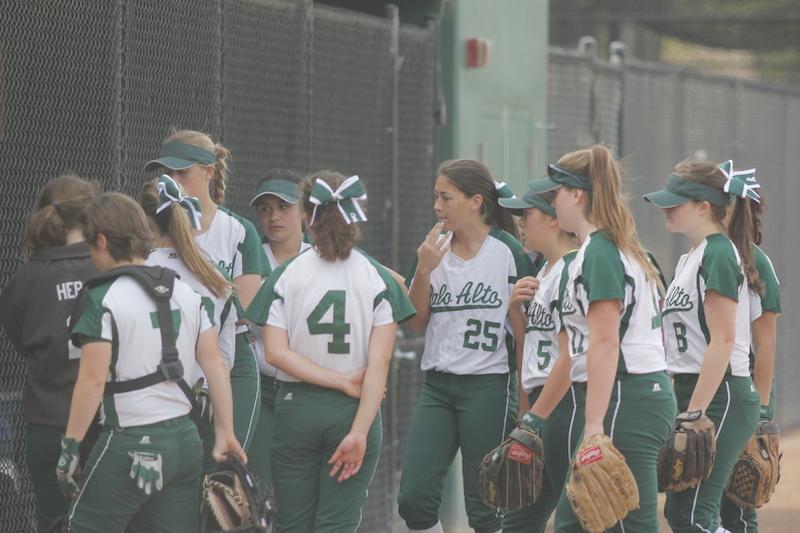 Softball convenes in between innings against Santa Clara on 3/20/15.