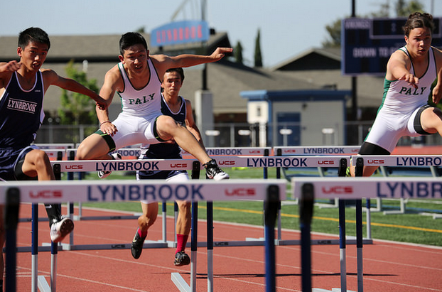 Junior hurdlers Connor Ng and Tak Nishi try to catch up to Lynbrook in the 110-meter high hurdles at Thursday's meet.  Photo by Malcolm Slaney.