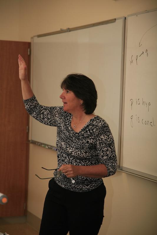 New Paly Athletic Director Kathy Bowers lectures her freshman Geometry Honors math class. This year,  Bowers is teaching one math class in addition to coordinating the Athletic Department. Photo by Cooper Lou.