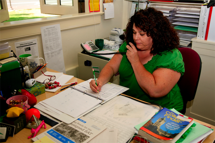Palo Alto High School's College Advisor Sandra Cernobori works at her desk in the College Center. In light of the changes implemented to the SAT, Cernobori recommends students to take the new SAT so that they can use the PSAT as a study took.  Photo by Cooper Lou.