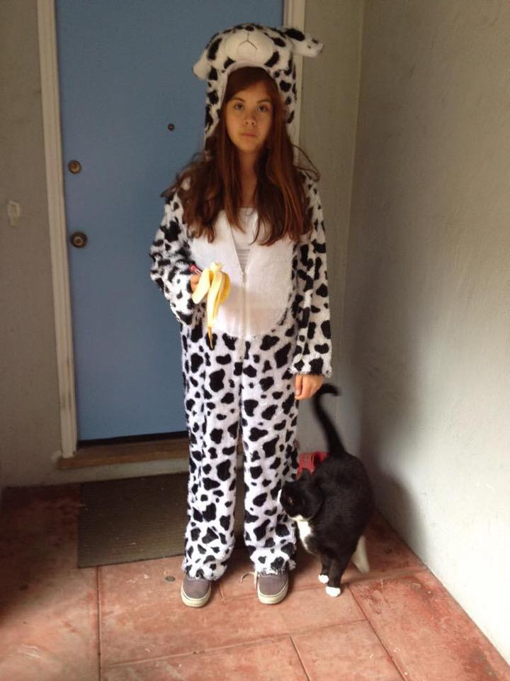 Mclntosh poses in her dalmatian costume for Halloween with a 1/2 eaten banana and her cat Chewy. Photo Courtesy [[[[courtesy]]] of Chelsea Mclntosh.