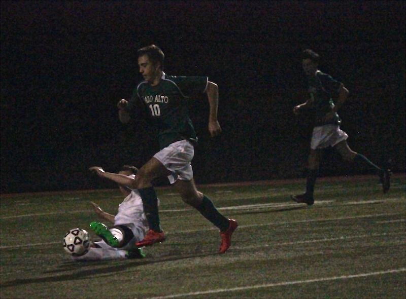 Junior midfielder Jack Stoksik overcomes his defender in the first half of the match against the Vikings' cross town rivals, the Gunn Titans. Stoksik provided two of the critical passes that led to the Vikings' first two goals of the game. Photo by Emma van der Veen.