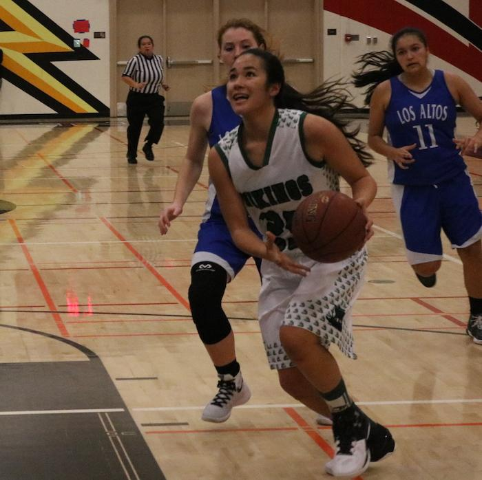 Junior guard Lauren Koyama drives to the basket in the second quarter against Los Altos High School. The Vikings went on to win 69-31. Photo by Sam Lee.