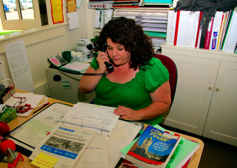 Palo Alto High School College Advisor Sandra Cernobori works at her desk in the College and Career center, answering questions about standardized tests.