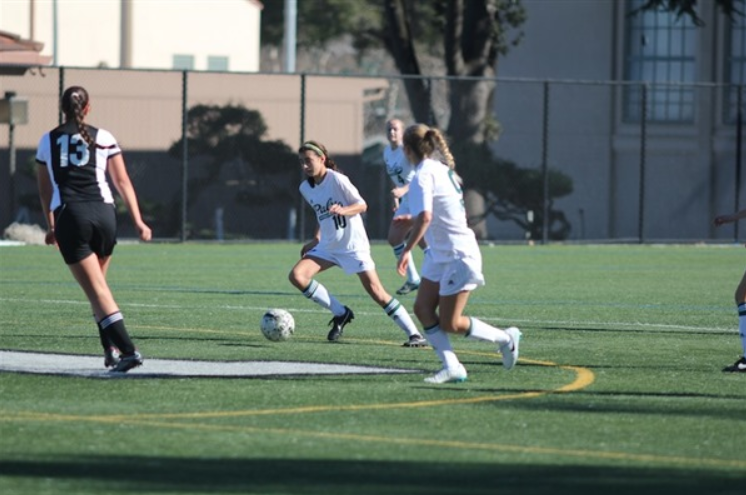 Sophomore Emily Tomz dribbles towards a Los Gatos defender as Paly takes an early 1-0 lead. The Vikings went on to win 3-0 keeping their perfect record. Photo by Bianca Al-Shamari.