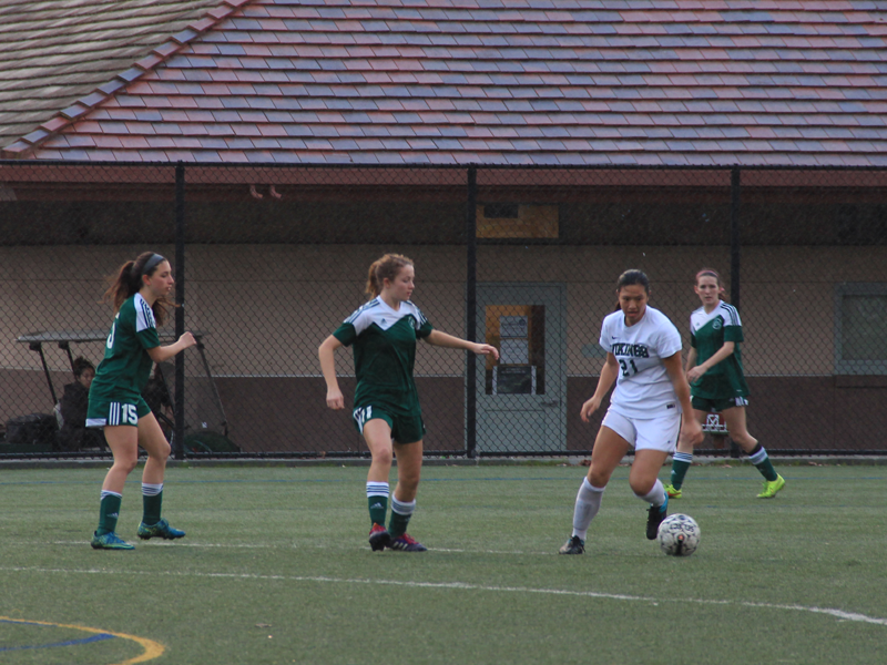 Paly class of 2016 alumnus Alison Lu dribbles the ball in a league match against Homestead High School. Lu, who now plays collegiate soccer at Williams College, was an essential piece to last years success. Photo by Ethan Kao.