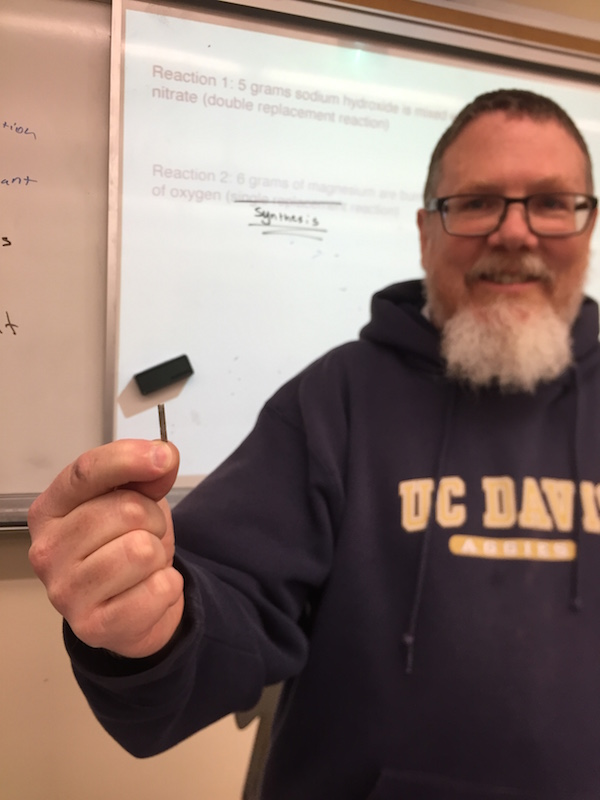 Chemistry teacher Ron Bowditch holds up a small strip of magnesium, similar to the one ignited today during 7th period that caused the fire alarm to go off. Bowditch has performed the demonstration many times before and has never encountered issues with the fire alarm.