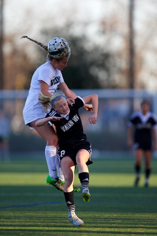 Senior Ansley Queen goes up for a header against Mountain View's Bethan Parry. Photo by Cooper Lou.