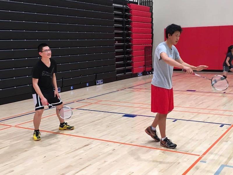 Freshman Raymon Chen and junior Kevin Zhang practice their doubles formation. Paly Badminton team will be facing off against Cupertino High School tomorrow. Photo: Miguel Moreno